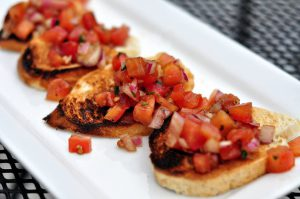 Bruschetta topped with tomatoes from Bar145