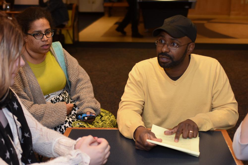 Visitor Jahmal McClendon discussed the intersections of Christian culture and the LGBTQ community with Yubi Orengo, senior fashion merchandising major, and other attendants. McClendon came to the event to gain a better, and more personal, understanding of LGBTQ people.