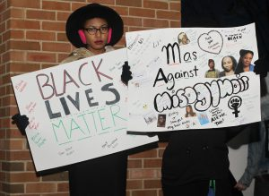 Fr. zoology major Jordin Manning holds a sign during the demonstration against Dr. Umar Johnson.