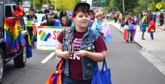 Sophomore English major Ollie Swasey represents the LGBTQ Student Center in the Kent Homecoming Parade on Saturday, Oct. 1, 2016.
