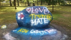 """Rock painted by KSU College Democrats with """"Love Trumps Hate."""" Sept. 7 2016. Photo by MJ Eckhouse"""