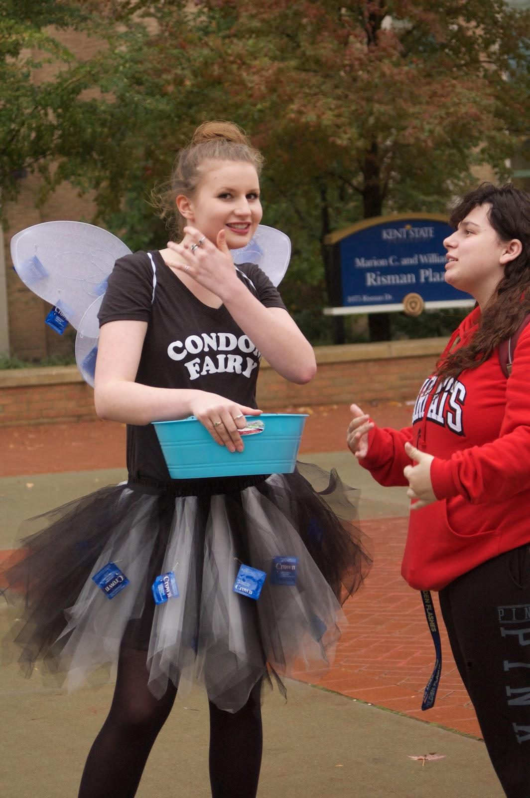 Clara Varndell, dressed as the Condom Fairy, hands out condoms to students on Risman Plaza during Sex Week.