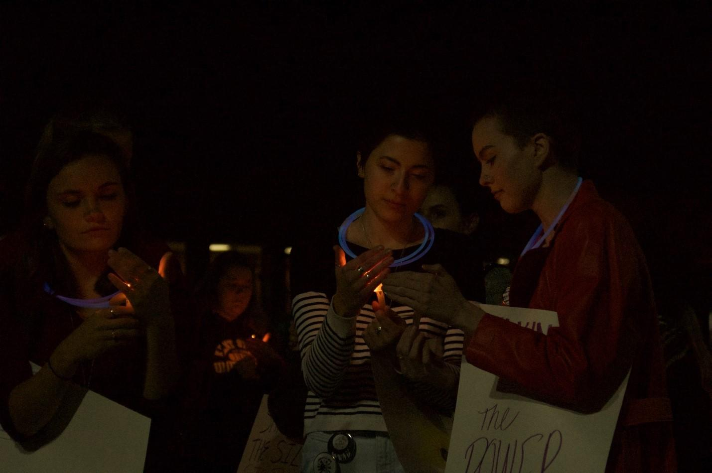 Students hold candles during Take Back the Night, an event held to raise awareness for sexual violence.