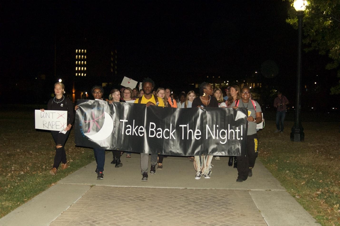 Students march from Risman Plaza to the Women's Center to raise awareness for sexual violence.