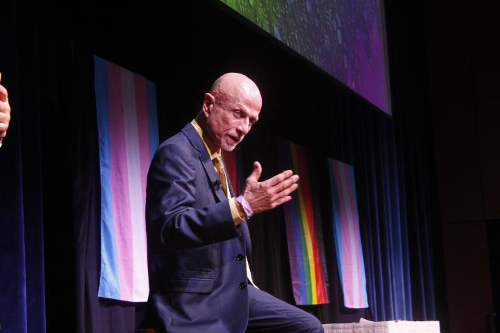 """Keynote speaker and Kent State alum Dr. Thomas Serwatka tells the audience about his many """"coming out"""" experiences. Serwatka said he feels that coming out is not a one time thing, but rather a continuous experience throughout one's entire life. Photo by Regan Schell."""