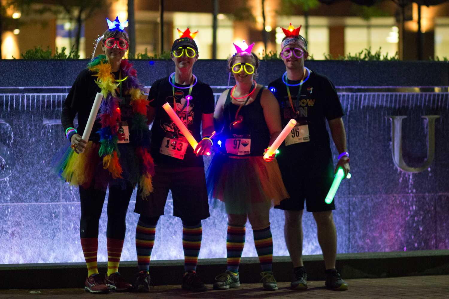 (Left to Right) Kathy Wilson, Tiffany Holler, Nicole Yoder and Andrew Yoder pose for a photo at the Rainbow Run 5k event outside the Kent State Student Center on Friday, Sept. 21, 2018. Photo by Sophia Adornetto.