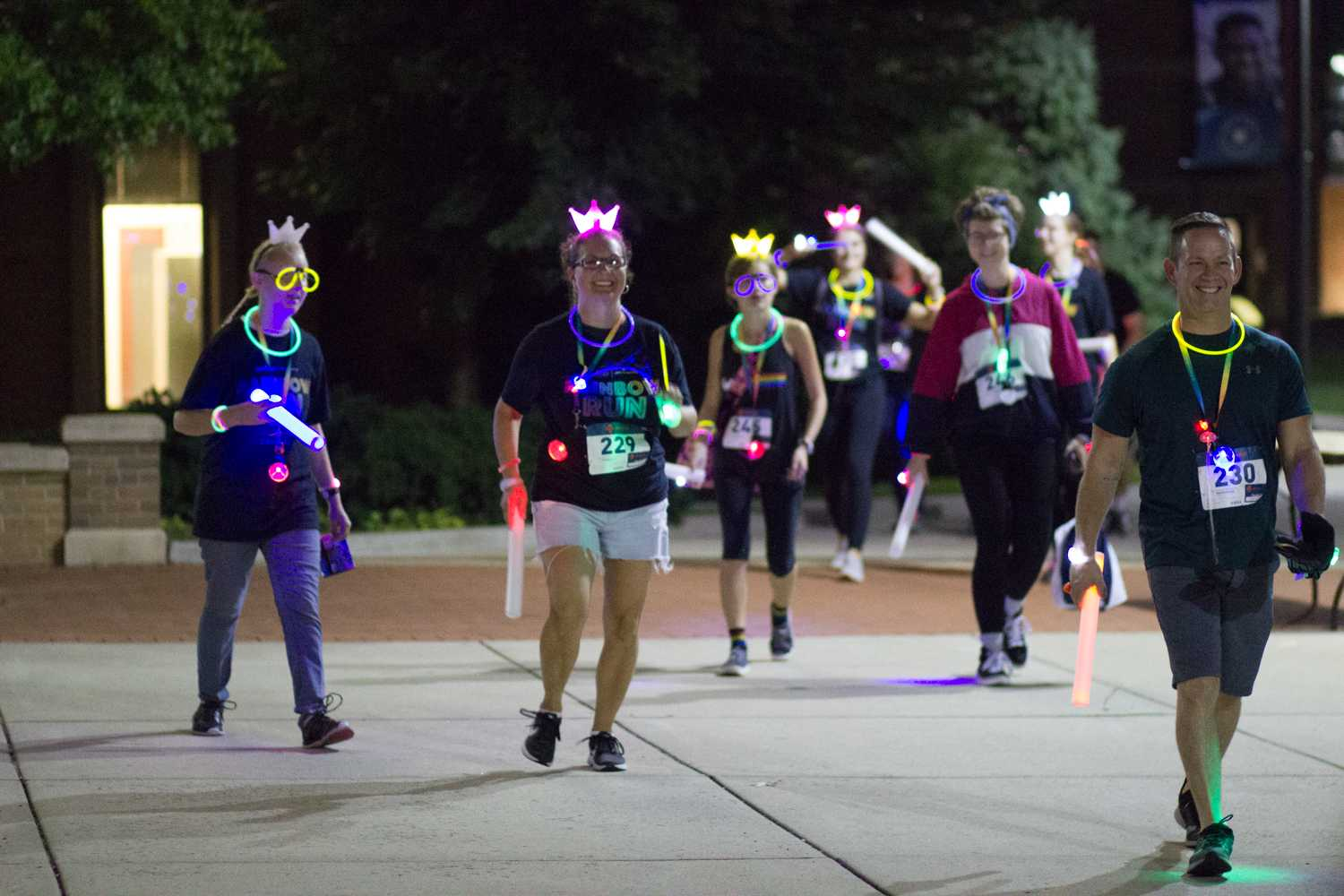 Participants of the Rainbow Run 5k smile as they finish the race outside the Kent State Student Center on Friday, Sept. 21, 2018. Not only did Kent students participate in the race, but families and friends of those who are part of the LGBTQ community came out to support their loved ones and the organization. Photo by Sophia Adornetto.