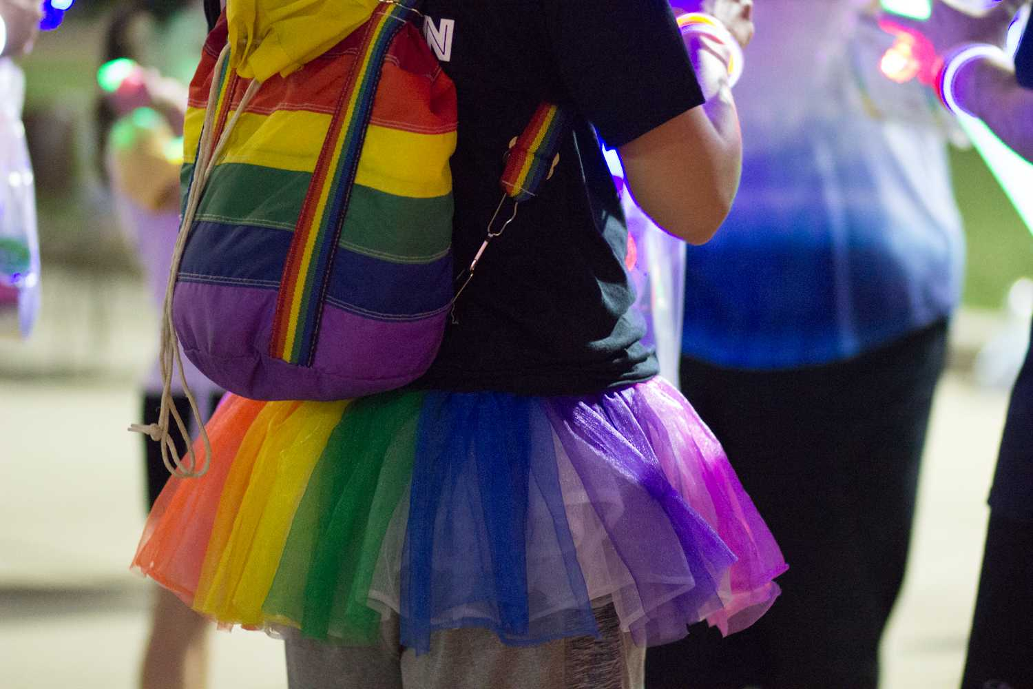 A participant of the Rainbow Race is decked out in a rainbow-colored tutu and backpack during the race outside the Kent State Student Center on Friday, Sept. 21, 2018. Photo by Sophia Adornetto.