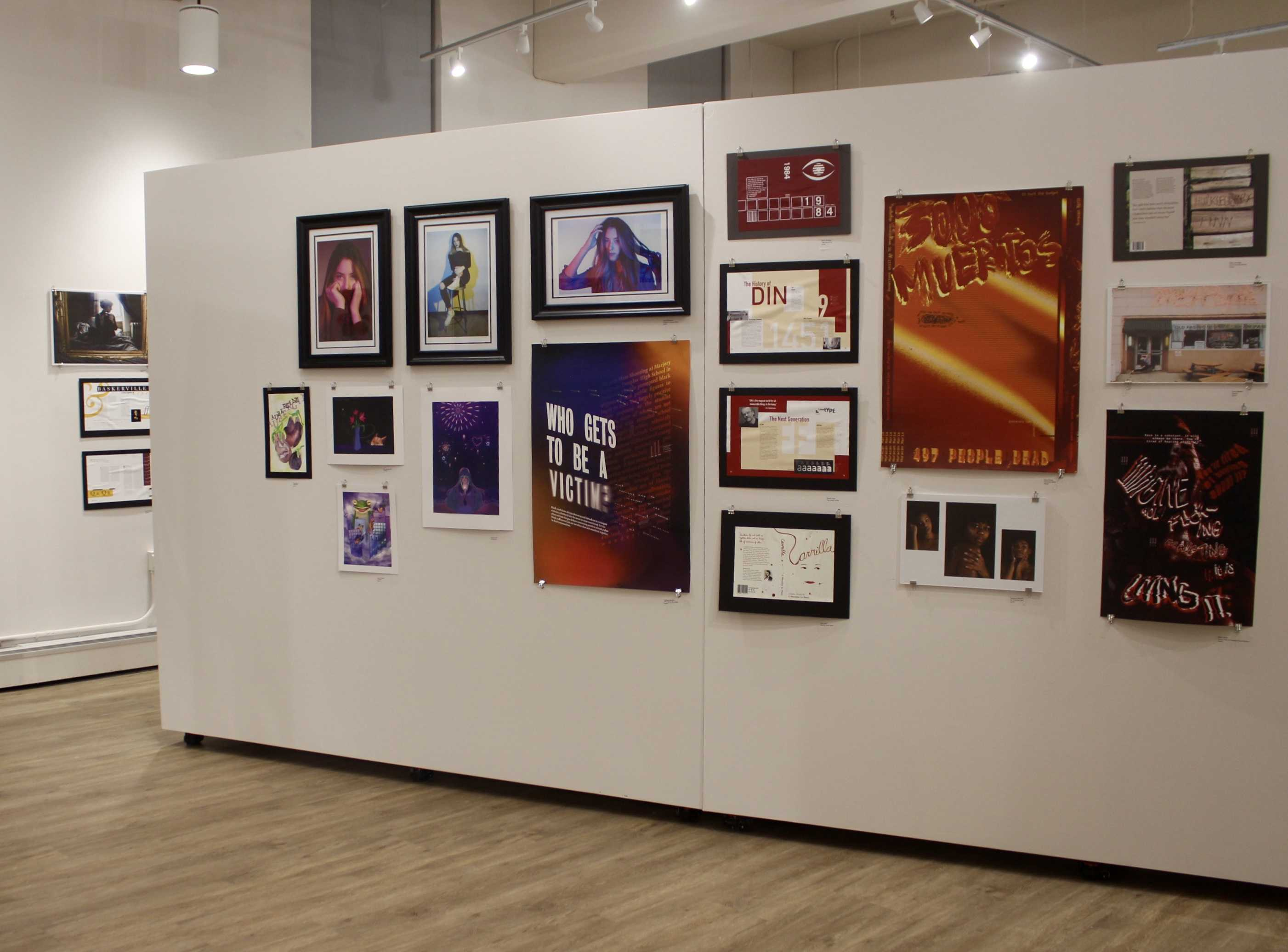 """Art hangs on the wall in Taylor Hall on Thursday, November 15, 2018. Some of the works displayed go hand in hand, showing the bystander effect. Some of the works display women photographed, some feature just a simple caption asking """"who gets to be a victim?"""" The closer you look at these works, it makes you think harder about being a bystander. Photo by Ashley Miller."""