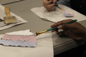 Students paint rocks for Transgender Day of Rememberance